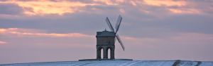 Chesterton Windmill, Warwickshire in sunset and winter field.